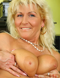 This Mature Mom with Big Boobs and Hairy Pussy is a Real Amateur She Plays with Her Floppy Tits While She Drills Her Cunt with Dildo