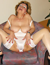 Old Milf Relaxing after Drinking Alcohol in a Hotel Room Allowing Herself a Little Bit too Much of Playing with Her Cunt
