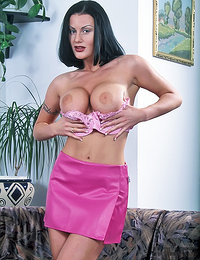Busty MILF is playing with her body while she's stripping out of her clothes as her boobs are full and nice she uncovers her ass as well